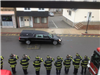 Stoneham Firefighters Pay Tribute to MIT Police Officer Sean Collier as the Procession Passes the Fi