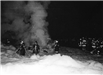 Firefighters Trudging Through Snow to Attend to a Fire 2