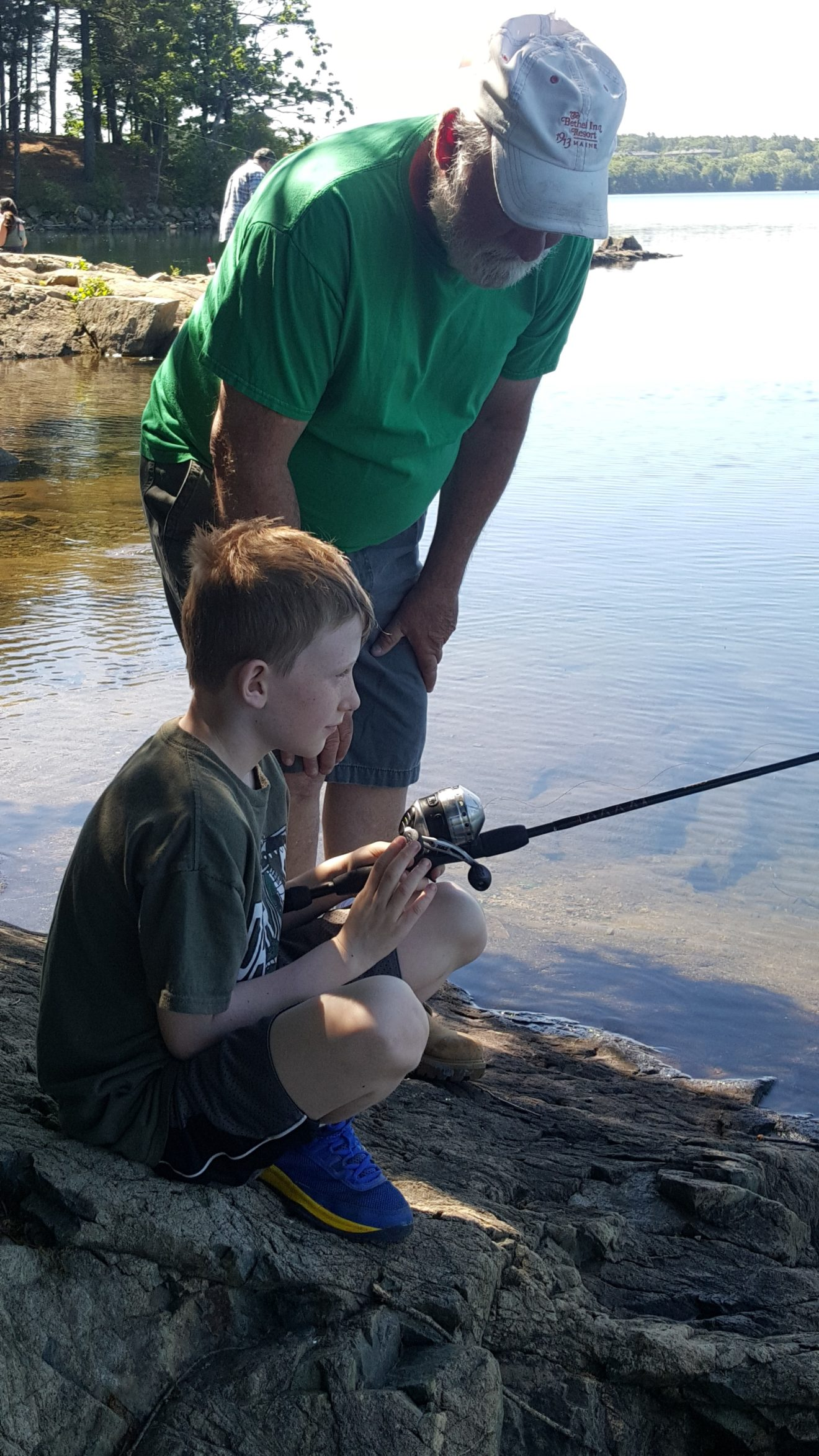 Kevin-Sweeney-age-7-getting-fishing-lesson-from-his-grandfather-1320x2347