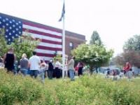 Group Standing in Front of the Displayed American Flag on Memorial Day