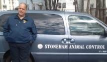 Brian Johnston Standing in Front of the Stoneham Animal Control Vehicle